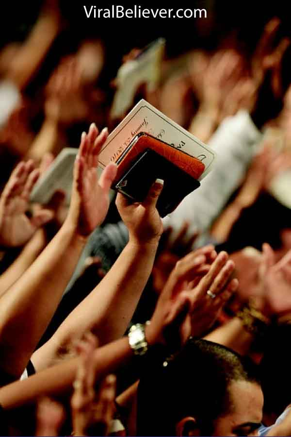 image of people worshiping at church