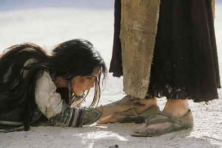 image of woman asking mercy from Jesus