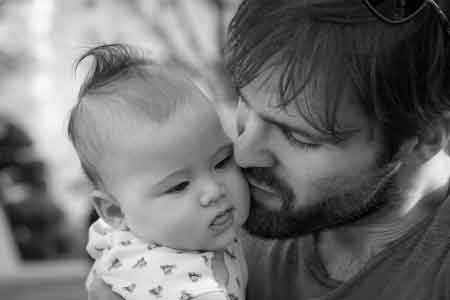 image of a father showing love to his child