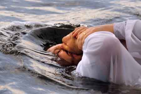 image of a man being baptized