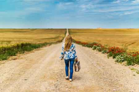 image of a woman alone on a deserted road