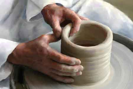 image of a potter and clay