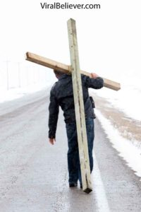 image of a man dying to self by carrying a cross
