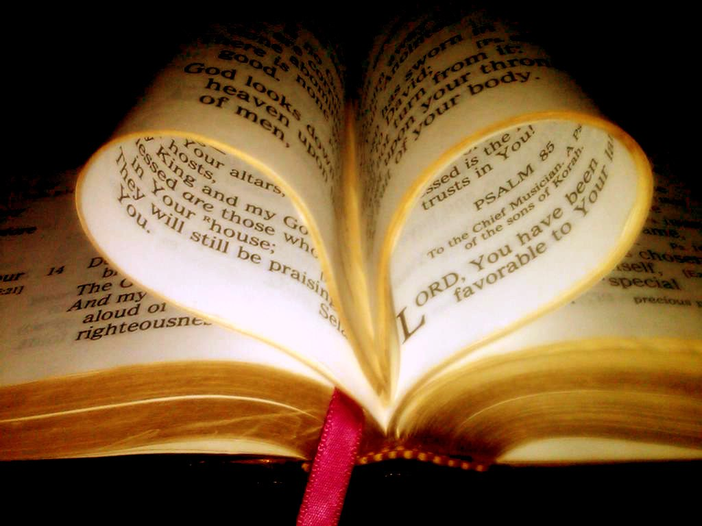 Image of the Bible with pages folded to make a heart