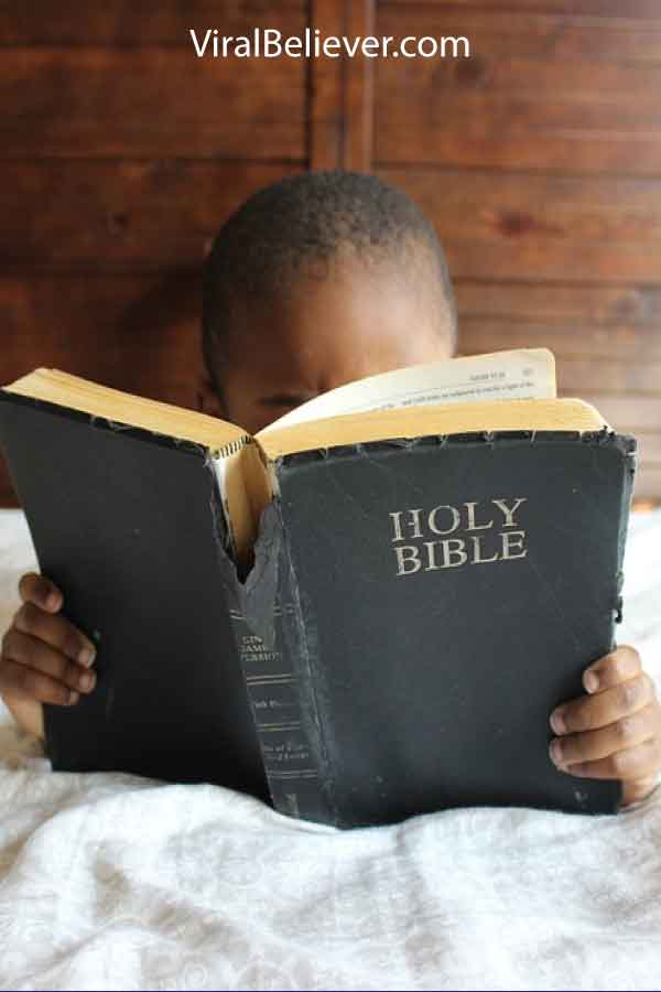 image of a 7 year old girl reading a bible