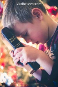 image of a 9 year old holding a Bible