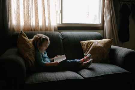 image of a young girl reading the Bible