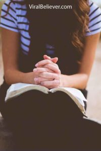 image of a teenage girl reading the Bible