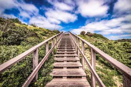 image of steps leading up to a higher goal