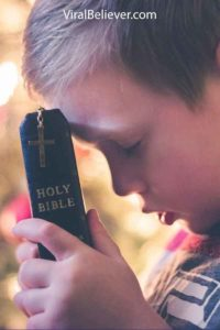 Image of a kid reading a bible
