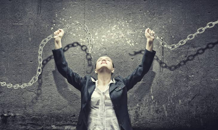 Image of a woman breaking chains of possession